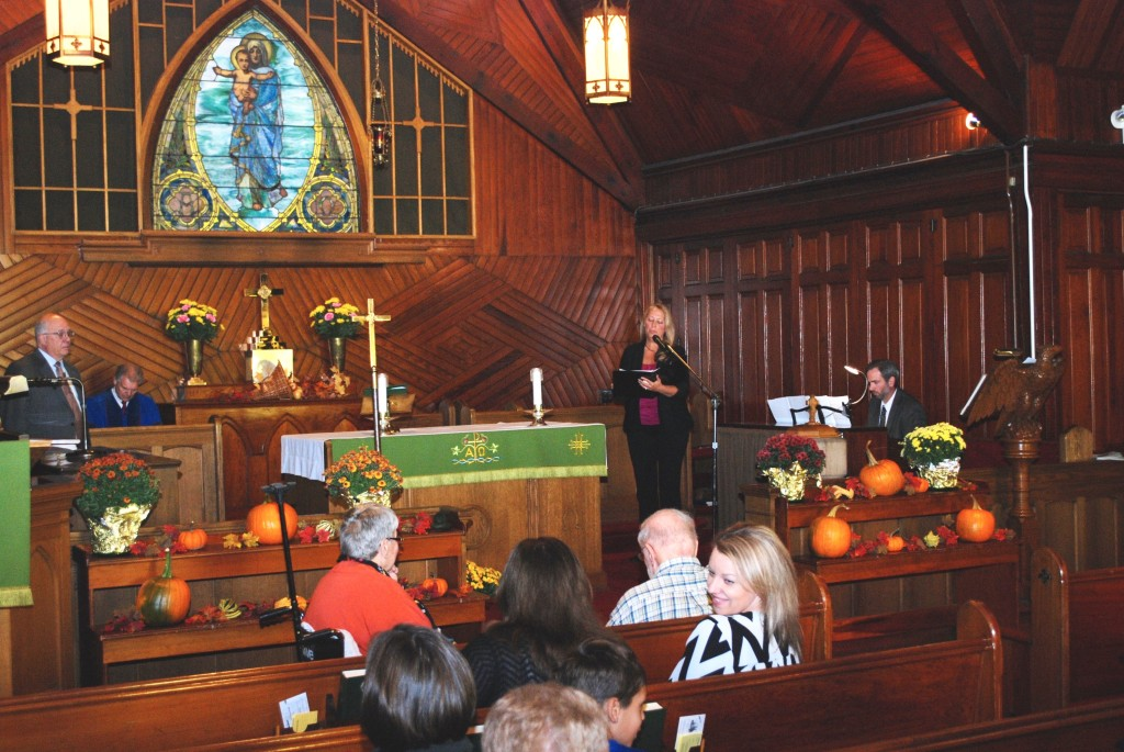 """Tammy Olderich sang """"Where Joy and Sorrow Meet"""" for the offertory as Tim Ryan accompanied her on the piano. The beauty of the sanctuary, the music, the flowers, and the autumn harvest all spoke to the wonder and glory of God."""